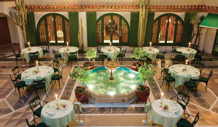Hostal de la Gavina Catalonia courtyard restaurant tables and chairs water feature