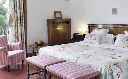 Hostal de la Gavina Catalonia family room bed armchair traditional décor