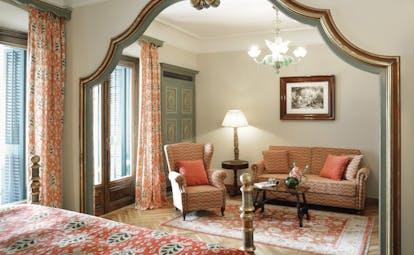Hostal de la Gavina Catalonia junior suite lounge area armchair sofa traditional décor