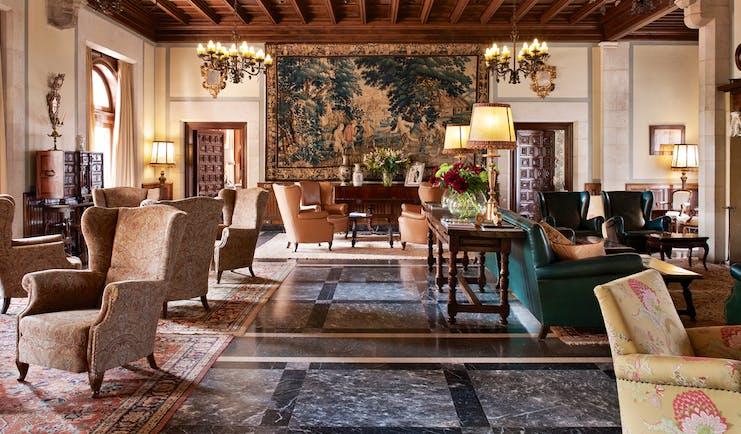 Hostal de la Gavina Catalonia lounge indoor communal seating area open fire traditional décor