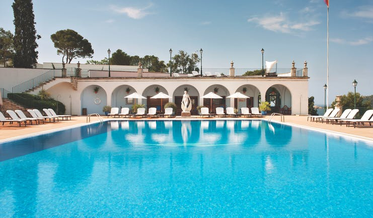 Hostal de la Gavina Catalonia pool sun loungers umbrellas