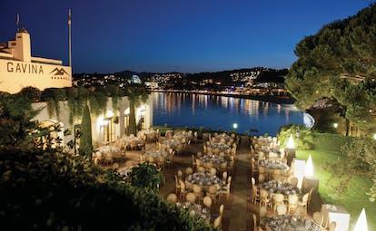 Hostal de la Gavina Catalonia restaurant terrace at night views over pool
