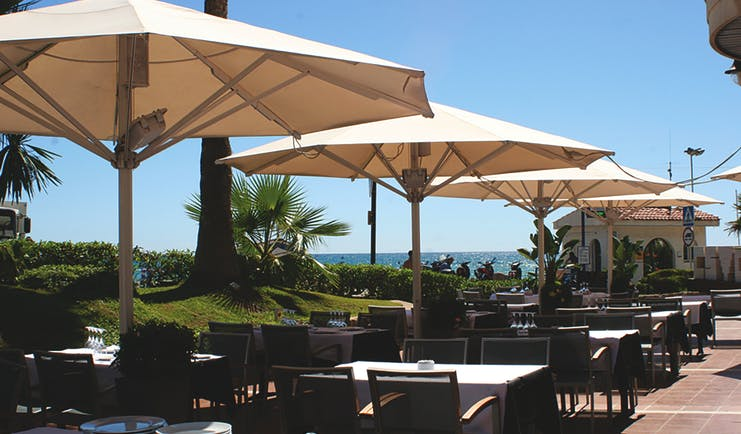 Hotel Estela Eastern Spain terrace outdoor dining area umbrellas sea views