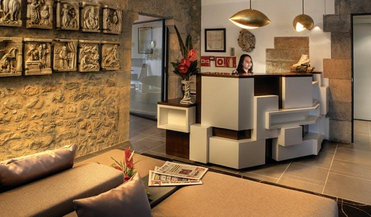 Hotel Llegendes de Girona Eastern Spain lobby desk sofas stone walls modern décor