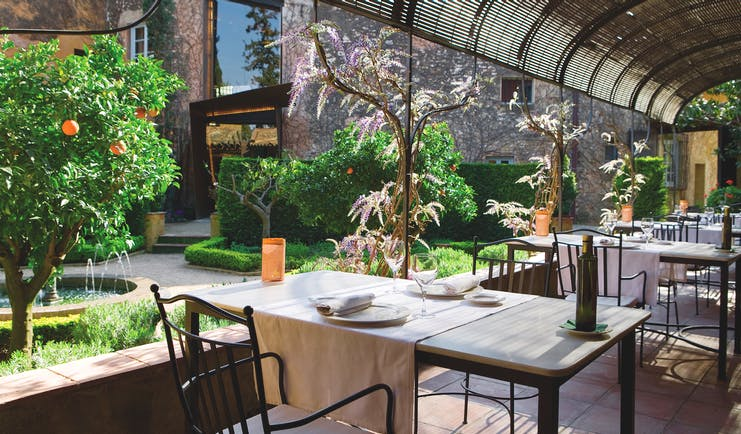 Hotel Mas la Boella Eastern Spain dining terrace outdoor dining gardens orange trees