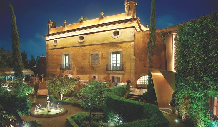 Hotel Mas la Boella Eastern Spain gardens at night hotel building garden trees shrubbery