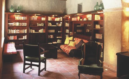 Hotel Mas la Boella Eastern Spain library indoor seating area bookshelves traditional décor