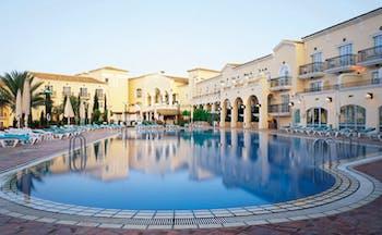 La Manga Club Resort Eastern Spain outdoor pool white hotel building sun loungers and umbrellas
