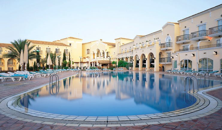 La Manga Club Resort Eastern Spain outdoor pool white hotel building sun loungers and umbrellas