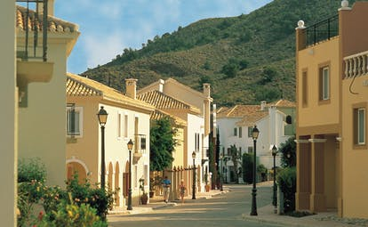La Manga Club Resort Eastern Spain street white and yellow buildings flowers wooded hillside