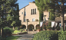 Mas de Torrent Catalonia hotel exterior building lawn trees pathway