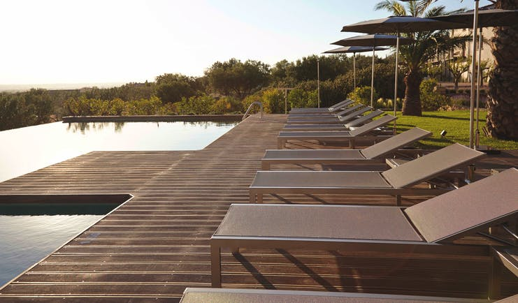 Mas Lazuli Eastern Spain infinity pool sun loungers umbrellas