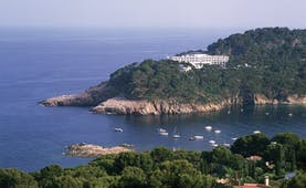 Parador de Aiguablava Costa Brava hotel exterior hotel nestled in cliffside sea boats