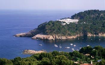 Parador de Aiguablava Costa Brava hotel exterior hotel nestled in cliffside sea boats