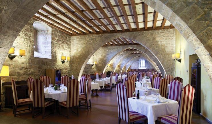 Parador de Cardona Catalonia restaurant indoor dining area medieval architecture