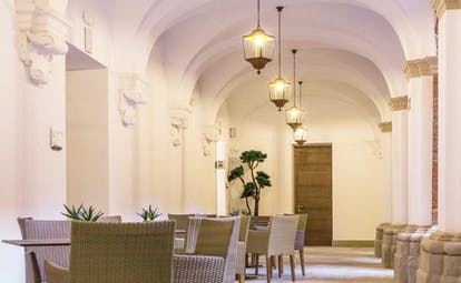 Parador de Lleida dining, tables and chairs, lights, clean and modern decor