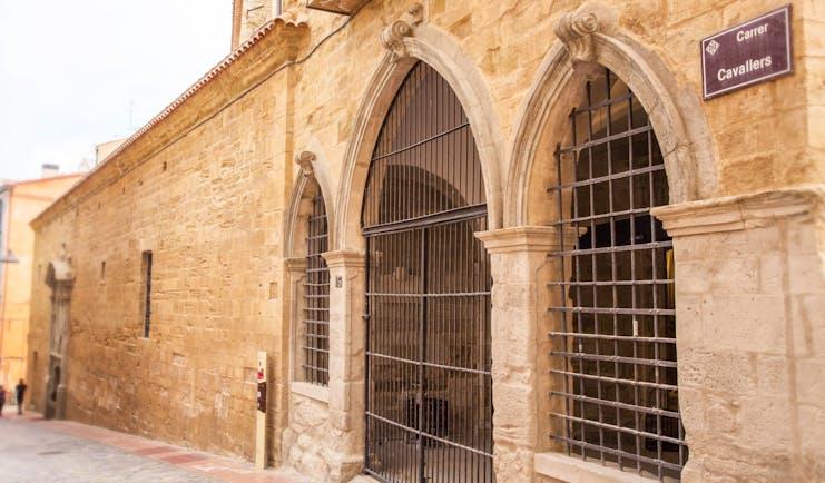 Parador de Lleida exterior, traditional architecture, old brick wall, metal gates