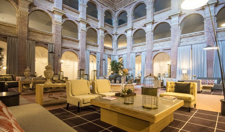 Parador de Lleida lobby lounge, tables, chairs, sofas, traditional architecture, tiled floors