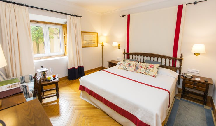 Parador de Ribadeo standard room, double bed, wooden floor, traditional decor