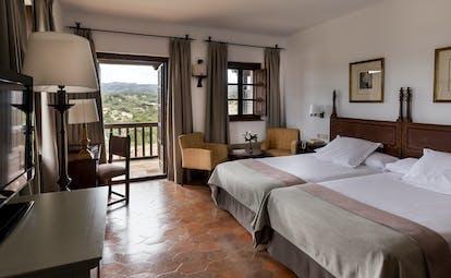 parador de tortosa spacious bedroom with two beds and a balcony