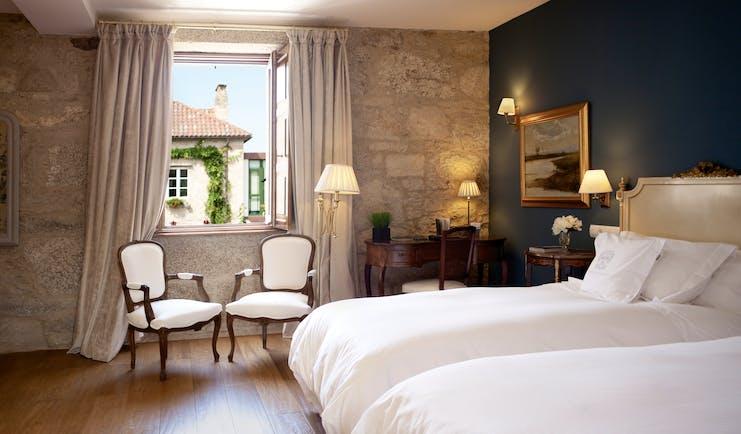 A Quinta Da Auga Galicia double room bed armchairs window elegant décor