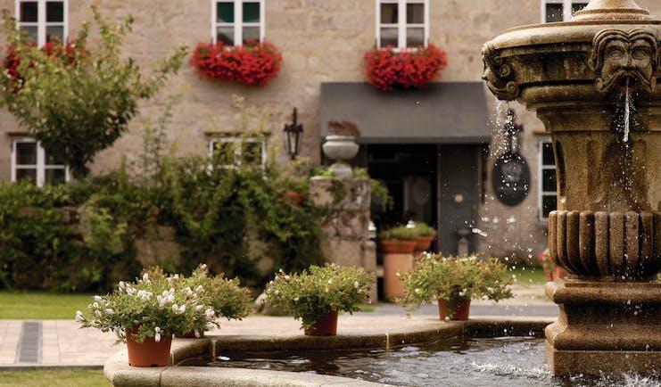 A Quinta Da Auga Galicia exterior stone building water feature plant pots