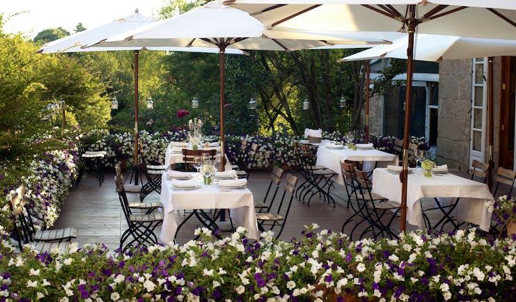 A Quinta Da Auga Galicia restaurant outdoor dining area umbrellas flowers