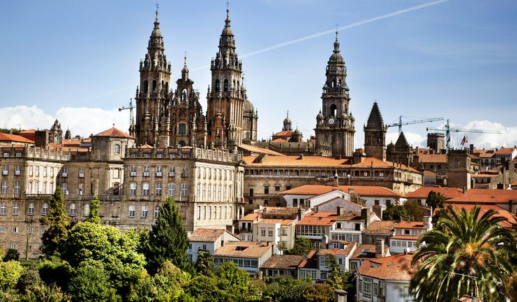 Towers of the cathedral above the red roofs of the town of Santiago de Compostela