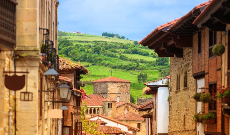 Golden stone houses of village scene in Santillana de Mar in Cantabria