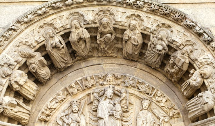 Stone carvings on the outside of a building in Obradoiro square in Santiago de Compostela