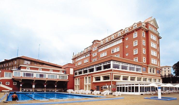 Hesperia Finisterre Green Spain pool hotel in background