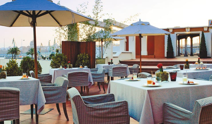 Hesperia Finisterre Green Spain terrace outdoor seating area tables umbrellas
