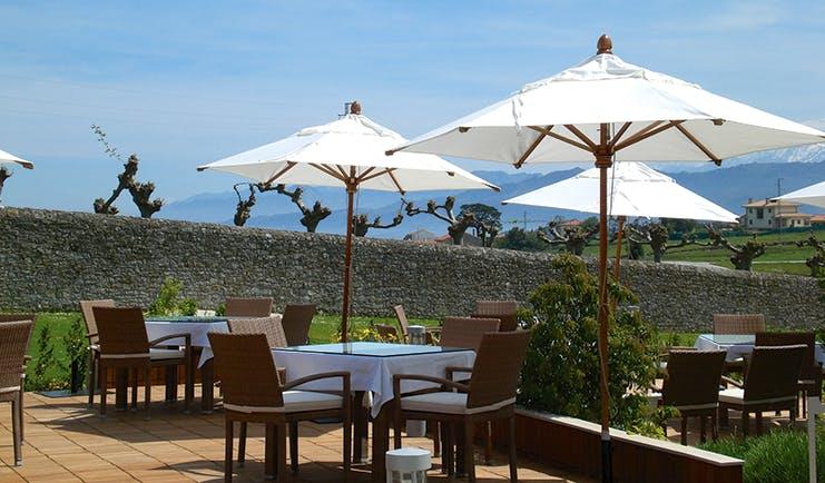 Palacio de Luces Green Spain terrace outdoor seating area umbrellas lawn shrubbery