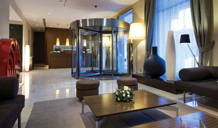 NH Collection Leon Plaza Mayor Green Spain lobby reception desk seating area revolving doors