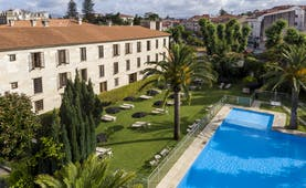 parador de cambados view of swimming pool and trees surrounding it