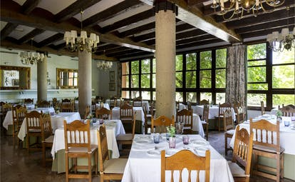 Parador de Gijon restaurant, dining tables, chairs, traditional decor