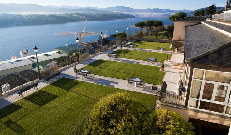 Parador de Ribadeo gardens, lawns, outdoor searinf, overlooking river and mountains