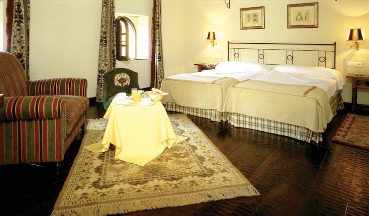 Parador de Santillana Gil Blas Green Spain bedroom sofa traditional décor