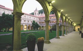 Parador de Santo Estevo Green Spain courtyard colonnaded walkways lawn