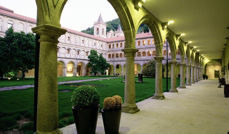 Parador de Santo Estevo Green Spain courtyard colonnaded walkways lawn