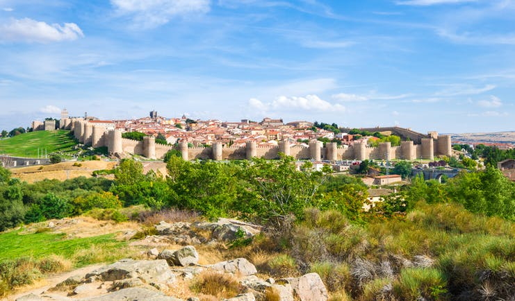 Perfect medieaval walls with turrets of the city of Avila