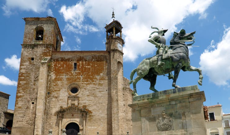 Statue of Francsico Pizarro on horseback outside the medieval stone church of St Martin in Trujillo