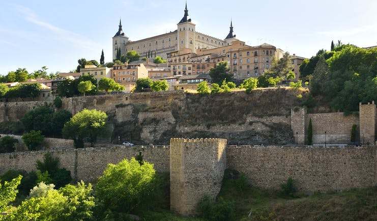 The square shaped Alcazar of Toledo on hill top above city fortifications