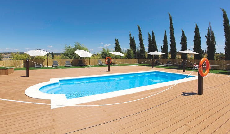 Hospes Palacio de Arenales Heart of Spain pool terrace lawns sun loungers umbrellas