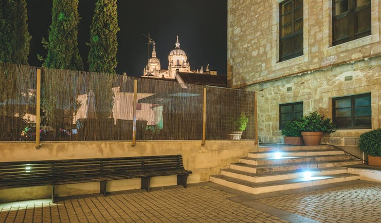 Hospes Palacio de San Esteban Heart of Spain patio at night cathedral in background