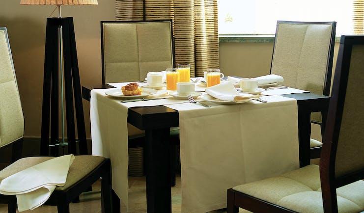 Palacio de la Merced Heart of Spain breakfast table orange juice modern décor