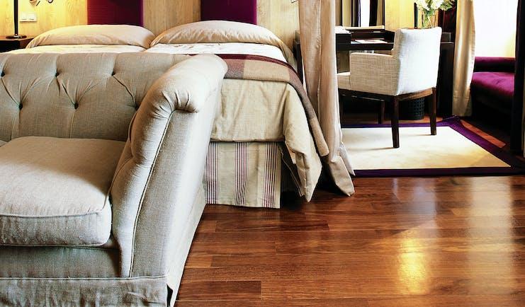 Palacio de la Merced Heart of Spain guestroom modern décor bed sofa