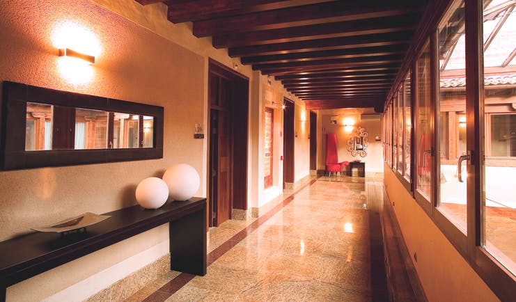 Palacio San Facundo Heart of Spain arcade hallway marble tiles ceiling beams modern décor