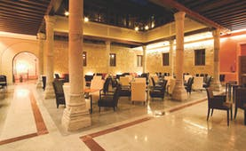 Palacio San Facundo Heart of Spain atrium indoor seating area marble floors columns modern décor