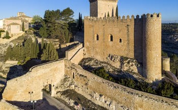 Parador de Alarcon yellow stone fortified castle with tower